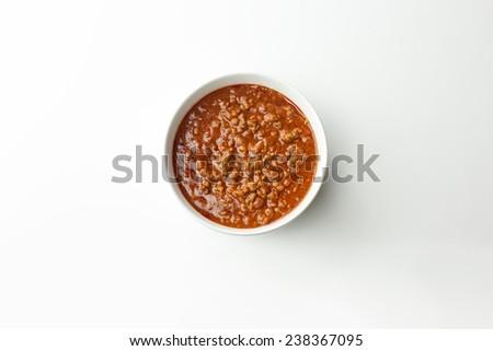 Bowl of chili on white background.  - stock photo