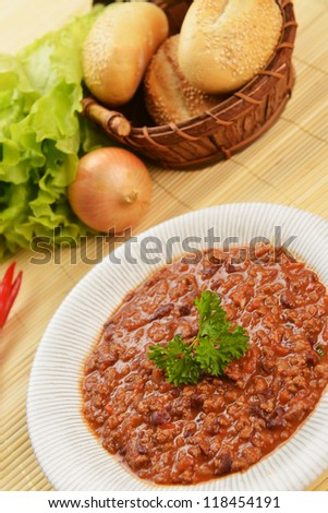 Bowl of chili with peppers and beans - stock photo