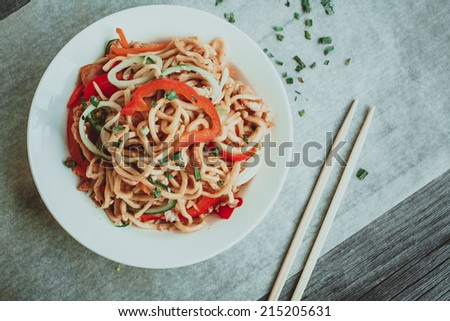 Bowl of chinese noodles with vegetables and shredded chicken. - stock photo