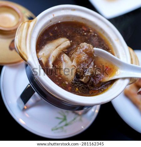 Bowl of Chinese shark fin hot and sour soup - stock photo