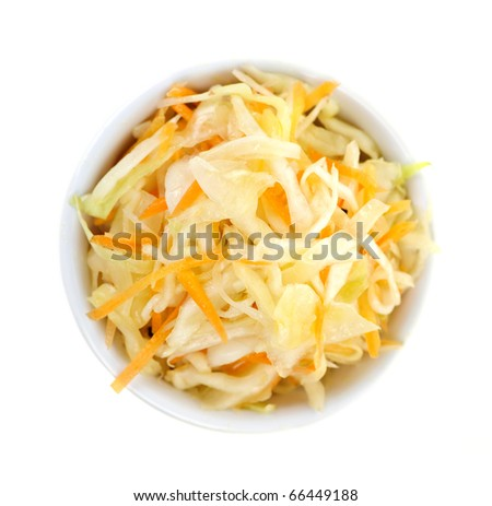Bowl of coleslaw on white background from above - stock photo