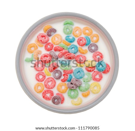 Bowl of colorful children's cereal and milk isolated on white with clipping path - stock photo