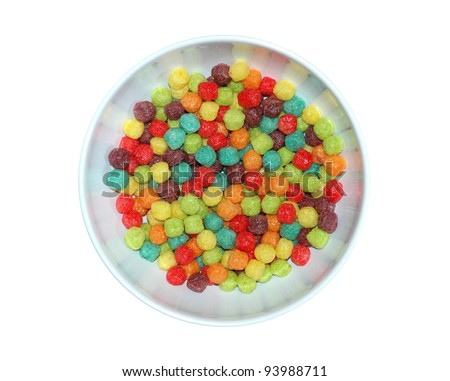Bowl of colorful corn puffed cereal isolated on white - stock photo