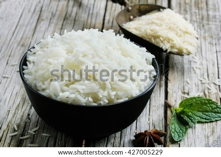 Bowl of cooked basmati rice /  Basmati rice bowl on wooden background, selective focus - stock photo