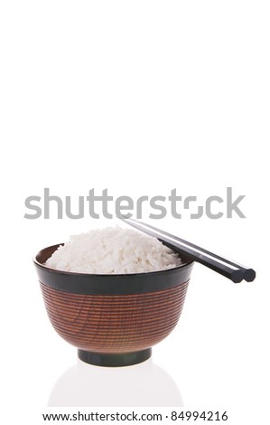 Bowl of cooked rice with chopsticks isolated on white background - stock photo