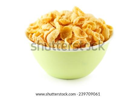 Bowl of cornflakes isolated on white - stock photo