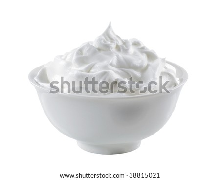 Bowl of cream isolated on white - stock photo