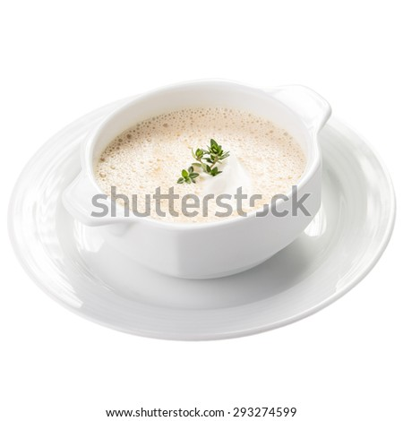 Bowl of cream soup isolated on white background - stock photo