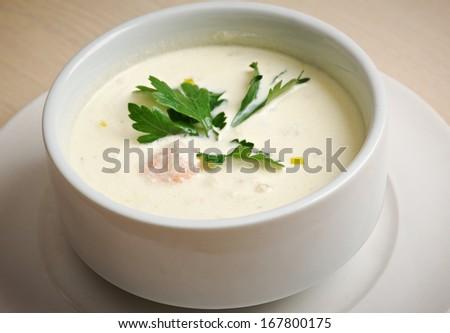 bowl of creamy   Norwegian soup with salmon - stock photo