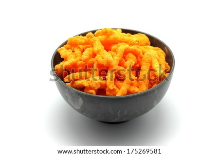 Bowl of crunchy cheese snacks isolated on white background - stock photo