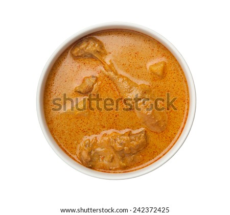 Bowl of curry chicken with lots of gravy isolated on white background  - stock photo