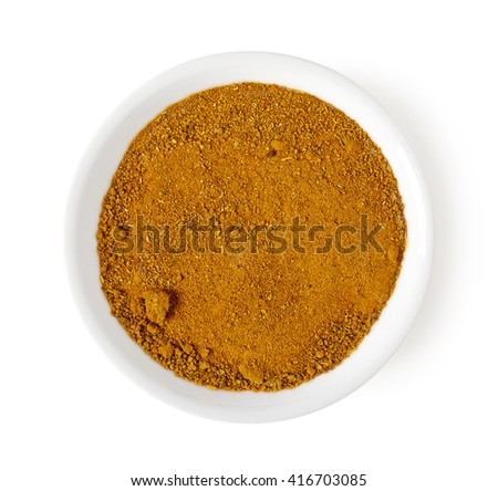 Bowl of curry powder isolated on white background, top view - stock photo