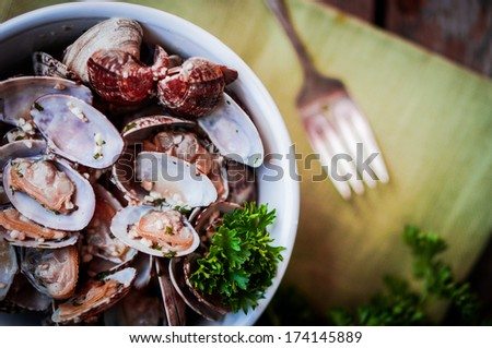 Bowl of Delicious Fresh Steamer Clams with Garlic and Basil on rustic ...