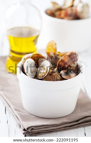 Bowl of Delicious Fresh Steamer Clams with Parsley and Garlic on wooden table, selective focus - stock photo