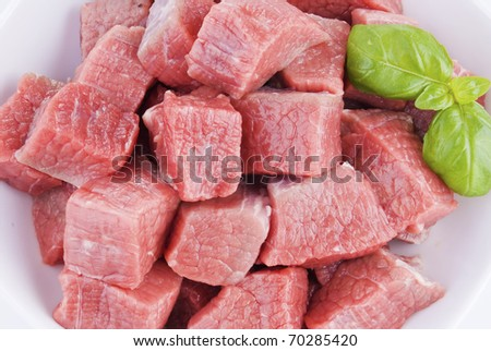 Bowl of diced beef over white background - close up - stock photo