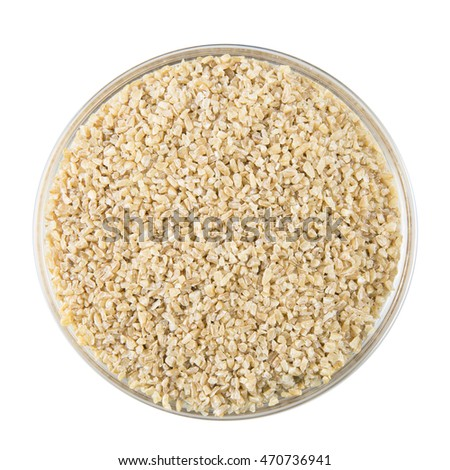 Bowl of dried bulgur wheat isolated on white background.