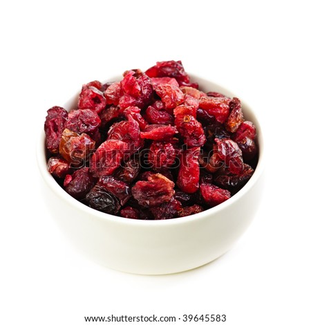 Bowl of dried cranberries isolated on white background - stock photo