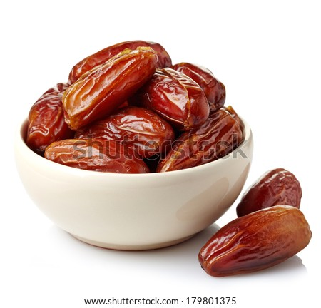 Bowl of dried dates isolated on white background - stock photo