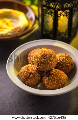Bowl of falafel and hummus and lantern. Food during holy month of Ramadan. - stock photo