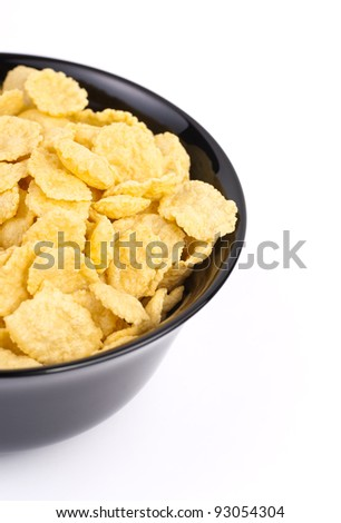 Bowl of flakes isolated on white background
