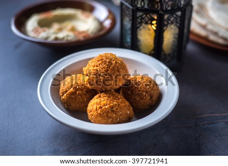 Bowl of fresh Falafel with hummus and Ramadan lamp. Ramadan special food. - stock photo