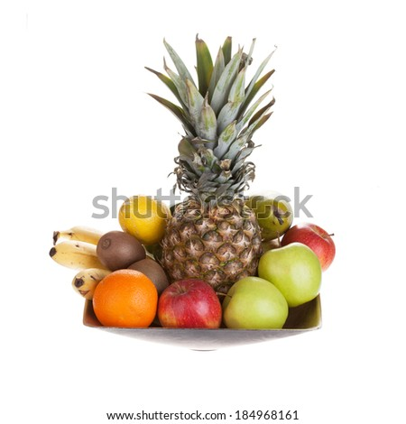 Bowl of fresh fruit, isolated on white background - stock photo