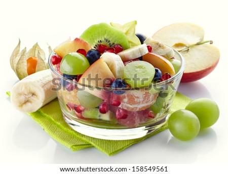 Bowl of fresh healthy fruit salad on white background - stock photo