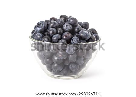 Bowl of fresh ripe organic blueberries on a white background - stock photo