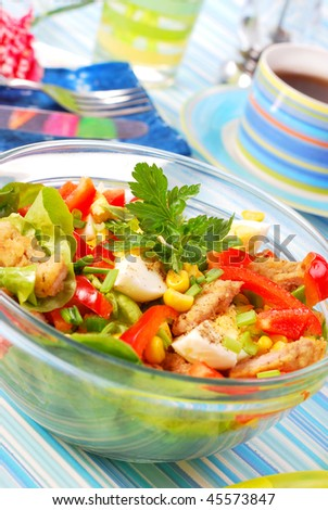 bowl of fresh salad with breaded meat and vegetables
