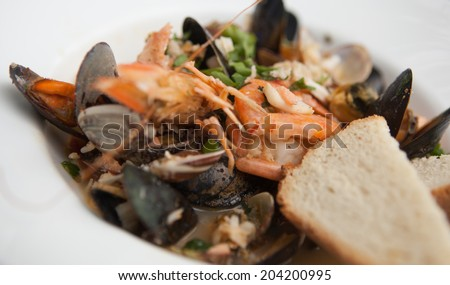 Bowl of fresh seafood soup