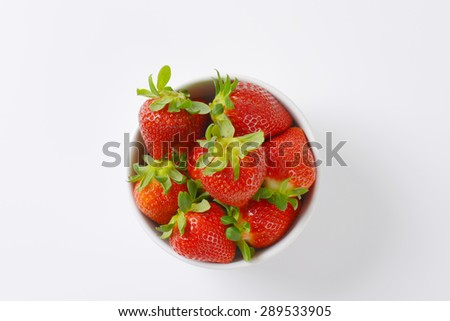 bowl of fresh strawberries on white background - stock photo