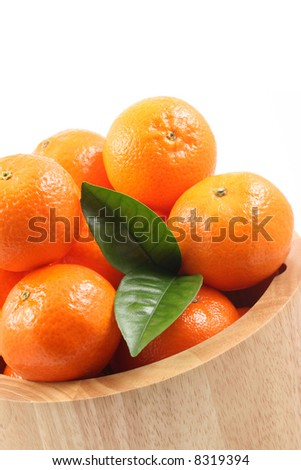 bowl of fresh tangerines isolated on blue