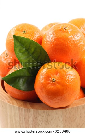 bowl of fresh tangerines isolated on white
