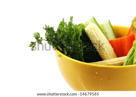 Bowl of fresh vegetables isolated on white. - stock photo