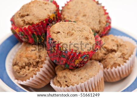 Bowl of fresh wholewheat flax seed banana muffins - shallow depth of field. - stock photo