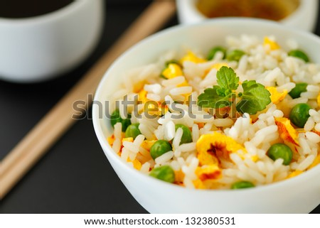 Bowl of fried rice, peas and egg with oyster sauce and aromatic oil - stock photo