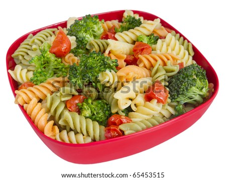 bowl of garden rotini salad with broccoli and tomatoes closeup isolated over white