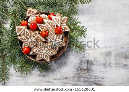 Bowl of gingerbread cookies on fir branches. - stock photo