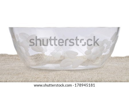Bowl of glass on linen - stock photo