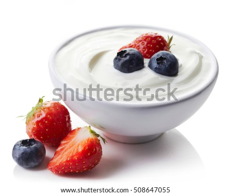 Bowl of greek yogurt and fresh berries isolated on white background