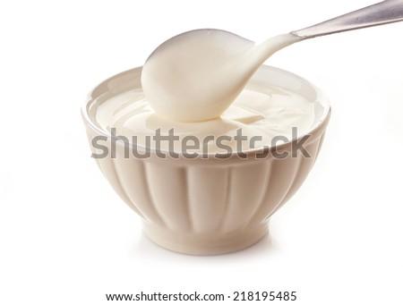 bowl of greek yogurt isolated on a white background - stock photo