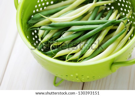 bowl of green and yellow beans - fruits and vegetables - stock photo
