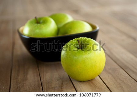 Bowl of green apples - stock photo