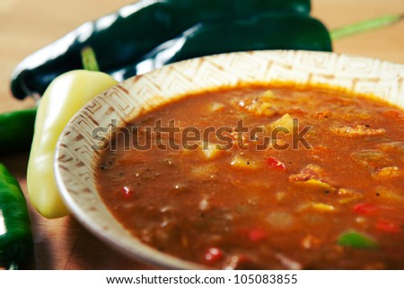 Bowl of green chile stew made in the New Mexico style with green chiles, jalapenos and peppers. - stock photo