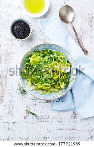 Bowl of Green Salad made with Lettuce, Leek and Sesame Seeds  - stock photo