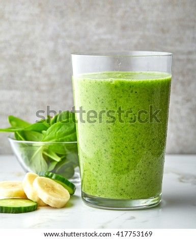 bowl of green smoothie on gray kitchen table