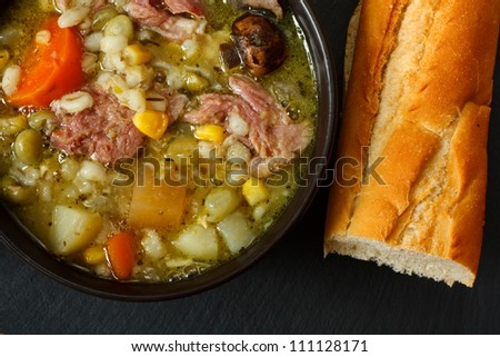 Bowl of ham stew with crusty bread - stock photo