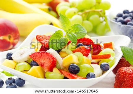 Bowl of healthy colorful fruit salad - stock photo