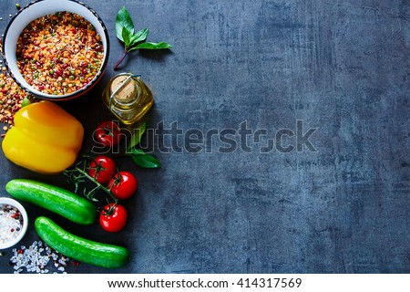 Bowl of healthy mix of red bean, lentil, green peas and chickpeas with fresh colorful vegetables, top view, place for text. Healthy Eating, Diet, Vegetarian or Cooking concept