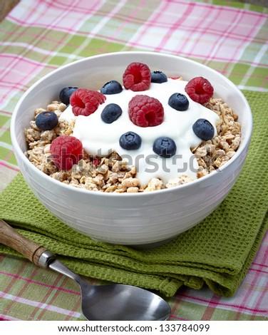 Bowl of healthy muesli with yogurt and fresh berries - stock photo